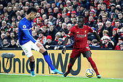 Liverpool forward Sadio Mane (10) takes on Everton defender Mason Holgate (2)  during the Premier League match between Liverpool and Everton at Anfield, Liverpool, England on 4 December 2019.