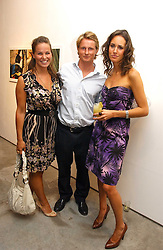Left to right, KATIE JOHNSON, GILES ROBERTS and LOUISE ROE at a private view of 'The Living is Easy' an exhibition of contemporary photography held at Flowers East, 82 Kingsland Road, London E2 on 10th August 2006.<br />