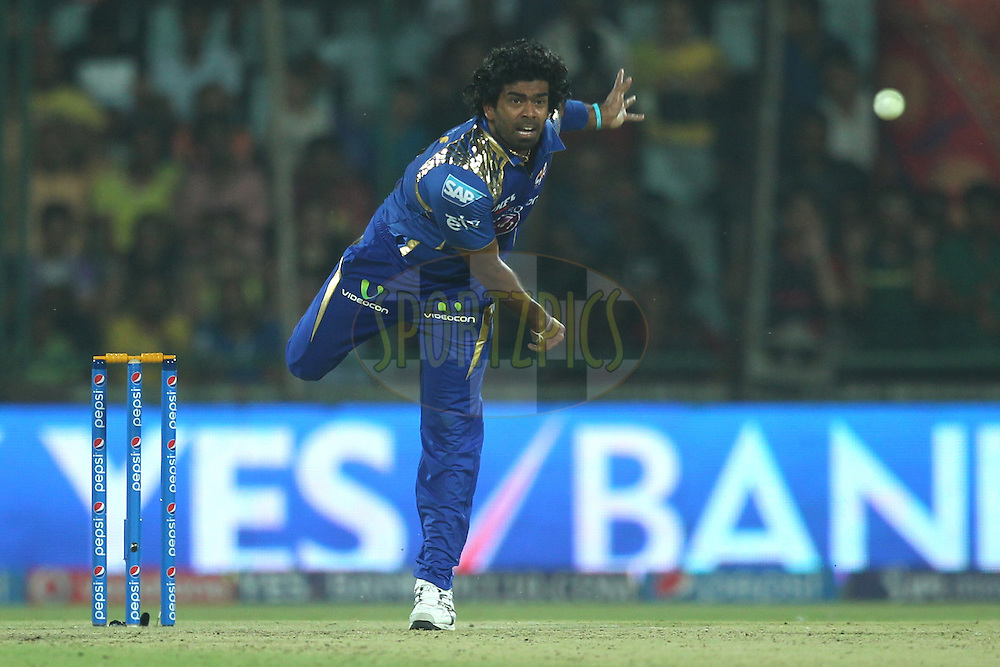 Lasith Malinga of the Mumbai Indians bowls during match 21 of the Pepsi IPL 2015 (Indian Premier League) between The Delhi Daredevils and The Mumbai Indians held at the Ferozeshah Kotla stadium in Delhi, India on the 23rd April 2015.<br /> <br /> Photo by:  Deepak Malik / SPORTZPICS / IPL