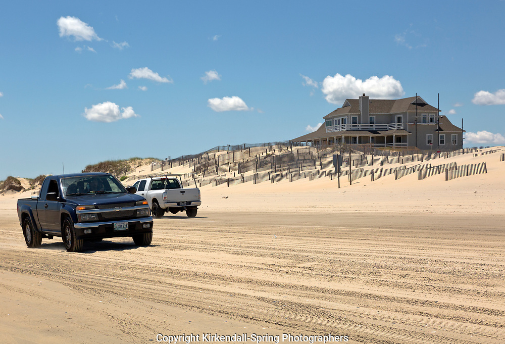NC01410-00...NORTH CAROLINA - Sand fences attempt to stablize a sand dune along the Atlantic Coast at the edge of a housing developement located beyond Corrola and the end of the road, accessed by driving on the beach.