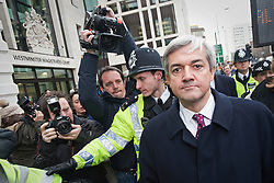 © Licensed to London News Pictures. 16/02/2012. London, UK. Liberal Democrat MP CHRIS HUHNE leaving Westminster Magistrates court in London on February 16th, 2012 where he faced charges of perverting the course of justice. Former Energy Secretary CHRIS HUHNE is accused of asking his ex-wife VICKY PRYCE to take speeding points on his behalf in 2003. Photo credit : Ben Cawthra/LNP