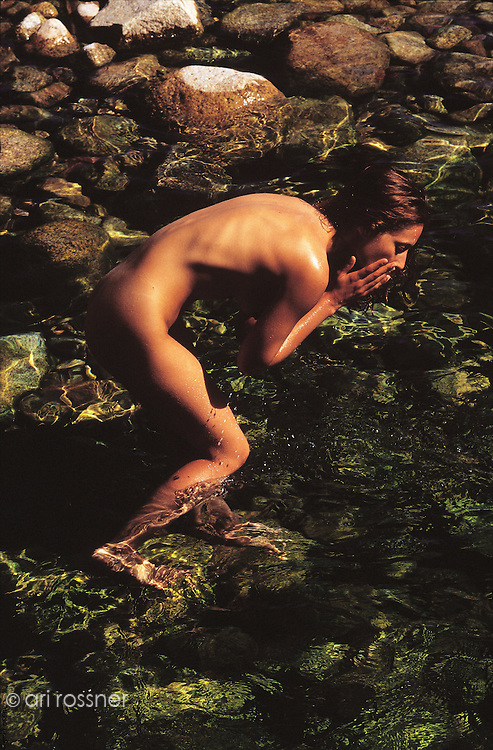 Nude woman bathing in the river