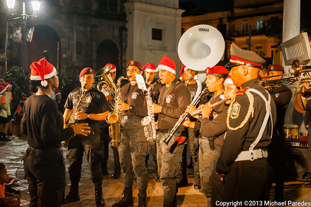 A band made up of local police perform at a Christmas concert in front of the Metropolitan Cathedral in the Casco Viejo section of Panama City, Panama.