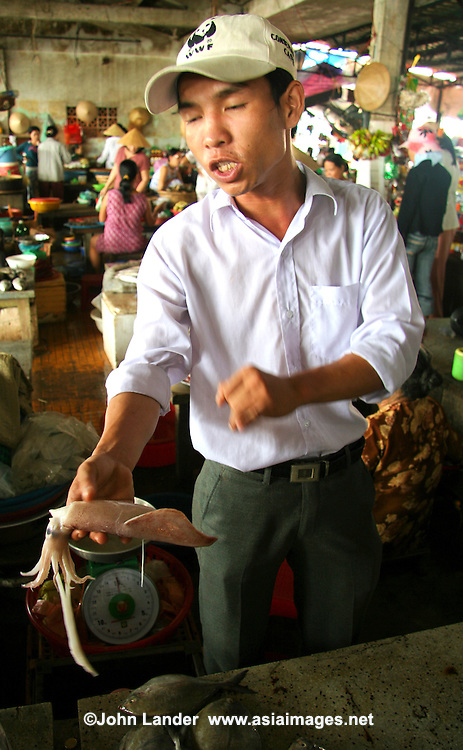 """Though most Vietnamese markets are very colorful and active, Hoi An's """"wet"""" market positively hums and vibrates with action from morning till mid afternoon.  Here you'll find everything from fresh crabs to herbs and produce to souvenir items."""