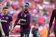 West Ham United midfielder Edimilson Fernandes (31) warms up before the Premier League match between Arsenal and West Ham United at the Emirates Stadium, London, England on 22 April 2018. Picture by Bennett Dean.