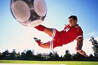 Soccer Player Kicking Ball --- Image by © Jim Cummins/CORBIS