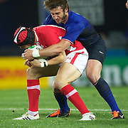 Maxime Medard, France, tackles Leigh Halfpenny, Wales, during the Wales V France Semi Final match at the IRB Rugby World Cup tournament, Eden Park, Auckland, New Zealand, 15th October 2011. Photo Tim Clayton...