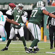 Quarterback Geno Smith, New York Jets, in action during the New York Jets Vs Miami Dolphins  NFL American Football game at MetLife Stadium, East Rutherford, NJ, USA. 1st December 2013. Photo Tim Clayton