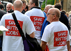 "© licensed to London News Pictures. LONDON, UK.  07/09/11. Men wear t-shirts that says ""Save British Jobs'.  A large group of Unite members working at Bombardier, along with business leaders and Derby councillors call on the government to ""save British train manufacturing"" outside parliament today. The delegation's visit, which coincides with the Transport Committee hearing, includes Unite general secretary Len McCluskey, the leader of Derby City Council and the Mayor of Derby.. Mandatory Credit Stephen Simpson/LNP"