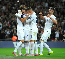 Wayne Rooney of England (Manchester United) celebrates scoring his penalty with team mates after he breaks the all time goal scoring record for England with his 50th international goal to surpass Bobby Charlton's record. - Mandatory byline: Dougie Allward/JMP - 07966386802 - 08/09/2015 - FOOTBALL - INTERNATIONAL - Wembley Stadium - London - England v Switzerland - European Championship 2016 Qualifiers - Group E
