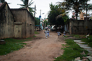 Children running along the road in the fort of Seringapatam. Seringapatam was the fort of Tipu sultan in India during the 1700's. Tipu was killed by the British army defending the fort.
