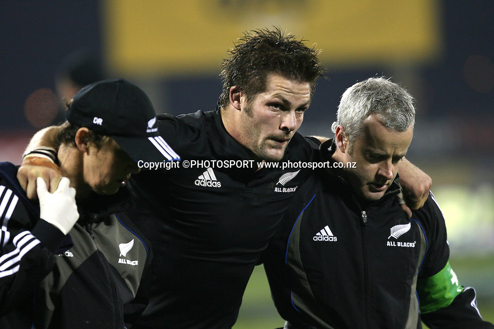 All Blacks captain Richie McCaw is helped from the field.<br />