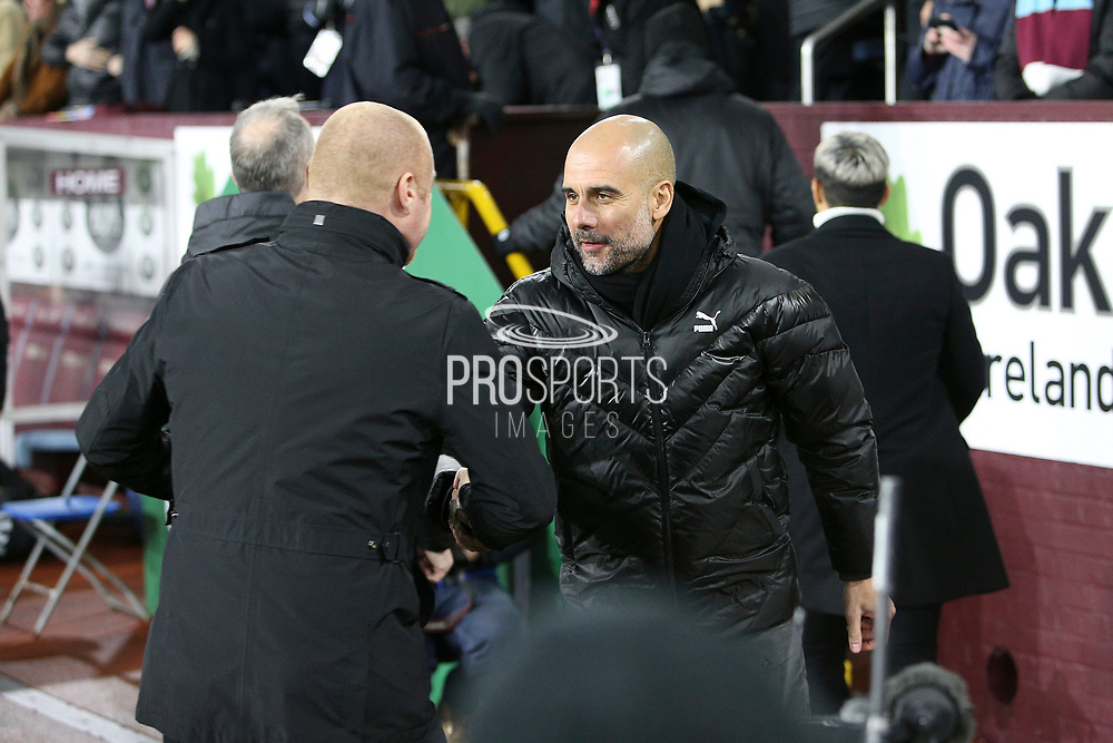 Manchester City Manager Josep Guardiola and Burnley Manager Sean Dyche shake hands during the Premier League match between Burnley and Manchester City at Turf Moor, Burnley, England on 3 December 2019.
