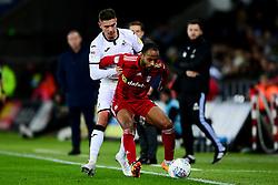 Kristoffer Peterson of Swansea City challenges Denis Odoi of Fulham - Mandatory by-line: Ryan Hiscott/JMP - 29/11/2019 - FOOTBALL - Liberty Stadium - Swansea, England - Swansea City v Fulham - Sky Bet Championship