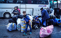 September 29, 2018 - Piraeus, Attica, Greece - A family of refugees wait to board a bus , following  they disembark from a ferry , at the Port of Piraeus , 29 September 2018.   Thousand migrants and refugees are scheduled to arrive at the Piraeus port from Lesbos by a ferry until end of September , as they lived with inhumane living conditions in the camp Moria. Authorities announced they will be transferring  by a coach bus towards in mainland Greece in the new camps. (Credit Image: © Giannis Alexopoulos/NurPhoto/ZUMA Press)