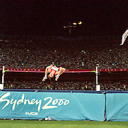 A panoramic image showing a high jumper in action at Sydney Olympic Stadium during the Men's High Jump competition at the 2000 Sydney Olympic Games...Panoramic images from the Sydney Olympic Games, Sydney, Australia.  2000 . Photo Tim Clayton