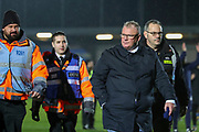 Gillingham manager Steve Evans walking off the pitch with security behind during the EFL Sky Bet League 1 match between AFC Wimbledon and Gillingham at the Cherry Red Records Stadium, Kingston, England on 23 November 2019.