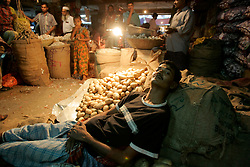 BANGLADESH DHAKA KAWRAN BAZAAR 2MARB05 - Porters and traders relax after a hard day's work at Kawran Bazaar vegetable market. The Bazaar has been in the Tejgaon area for at least 30 years and is one of the largest markets in Dhaka city...jre/Photo by Jiri Rezac..© Jiri Rezac 2005..Contact: +44 (0) 7050 110 417.Mobile:  +44 (0) 7801 337 683.Office:  +44 (0) 20 8968 9635..Email:   jiri@jirirezac.com.Web:    www.jirirezac.com..© All images Jiri Rezac 2005- All rights reserved.