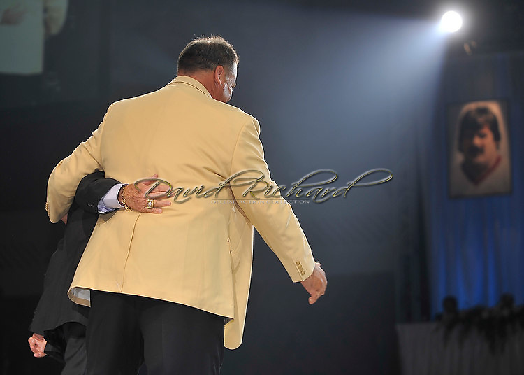 """Former Washington Redskins offensive lineman Russ Grimm was enshrined into the Pro Football Hall of Fame in Canton, Ohio, on August 7, 2010 at Fawcett Stadium..Grimm, a member of the 1980s offensive line called """"The Hogs"""", went into the Hall with Rickey Jackson, Dick LeBeau, Floyd Little, John Randle, Jerry Rice and Emmitt Smith..Grimm is currently the Arizona Cardinals' assistant head coach, offensive line coordinator and run game coordinator..Photos by David Richard."""