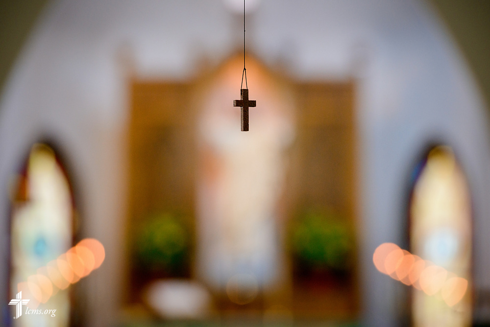 A small cross dangles from the ceiling at Zion Evangelical Lutheran Church, Lu Verne, Iowa, on Sunday, July 9, 2017. LCMS Communications/Erik M. Lunsford