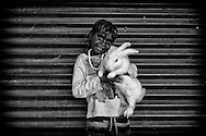 Romaine showing off his pet rabbit in One Mile Community. Broome, Western Australia ©Ingetje Tadros/Diimex
