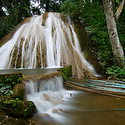 The Nong Khoi waterfall in Chiang Mai province showing how villagers are tapping the waterfall to provide a natural pressurized water supply to their homes.