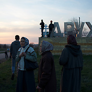 People gather around a group of pro-Russia activists, taking guard at a newly build checkpoint outside Slavyansk. The eastern Ukranian city was taken under control by a pro-Russia militia.