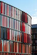 Europa, Deutschland, Nordrhein-Westfalen, Koeln, das Buerogebaeude Cologne Oval Offices der Architekten Louisa Hutton und Prof. Matthias Sauerbruch am Gustav-Heimeann-Ufer 72-74. Das Gebaeude verfuegt ueber ein uebergeordnetes Energie- und Lueftungskonzept, dass z.B. das Rheinwasser zur Kuehlung des Gebaeudes nutzt, es ist in energiesparender Bauweise errichtet, 105 kWh/m&sup2;/Jahr nach EnEV. - <br /> <br /> Europe, Germany, North Rhine-Westphalia, Cologne the office building Cologne Oval Offices by the architects Louisa Hutton und Prof. Matthias Sauerbruch at the street Gustav-Heinemann-Ufer 72-74, the building has a superior energy and air-conditioning concept, e.g. using the water of the Rhine to cool the building, it is build in a energy-saving construction, 105 kWh/m&sup2;/year German Energy-Saving Regulation EnEV.