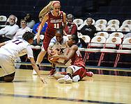 "Arkansas' Calli Berna (11), Arkansas' Dominique Robinson (21), and Ole Miss' Kenyotta Jenkins (11) and Valencia McFarland (3) go for the ball at the C.M. ""Tad"" Smith Coliseum in Oxford, Miss. on Thursday, January 12, 2012."