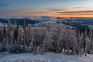 The views at sunrise were stunning from the Granite Butte fire lookout on Montana's continental divide. All the whitebark pine trees were coated with thick rime ice and fog drifted around the valleys.