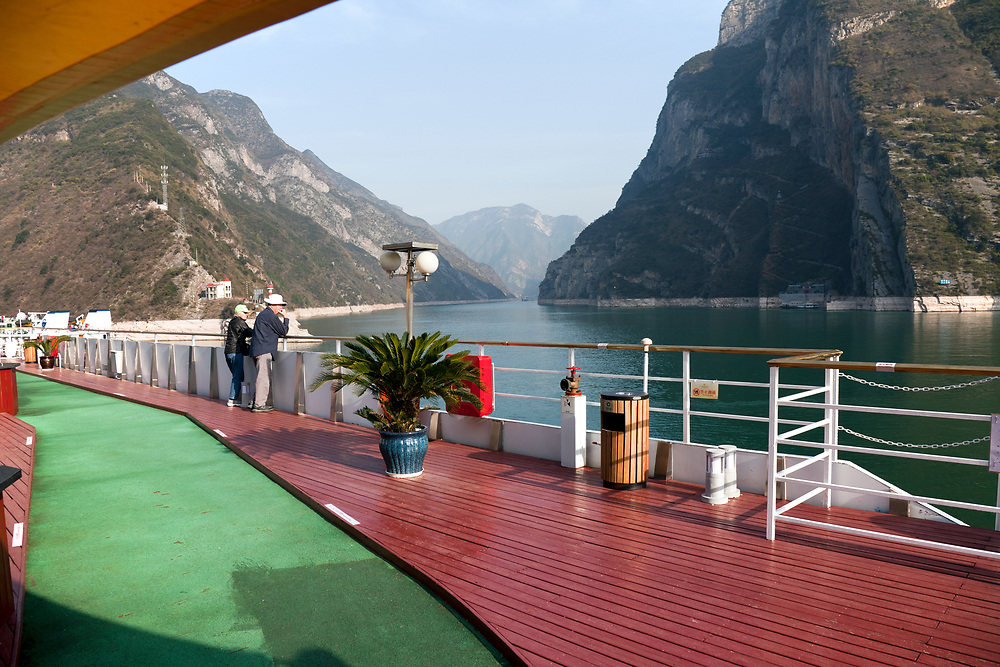 Couple cruising the Yangtze River near the Three Gorges Dam, China, aboard the Sinorama Gold 8 riverboat.