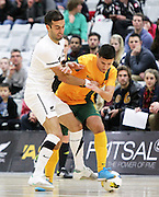 New Zealand's Lucas Cordeiro Osorio Da Silva and Australia's Marino Musumeci compete for the ball during the 2013 ASB Trans Tasman Cup. Futsal Whites v Futsal Roos. ASB Sports Centre, Wellington.  Friday 19 July 2013. Photo: Justin Arthur / photosport.co.nz