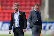 Motherwell manager Stephen Robinson looks shocked at a decision, as Tommy Wright, manager of St Johnstone FC smiles behind him during the Ladbrokes Scottish Premiership match between St Johnstone and Motherwell at McDiarmid Stadium, Perth, Scotland on 11 May 2019.