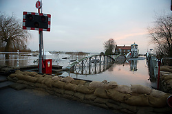 © Licensed to London News Pictures. 28/12/2015. Cawood, UK. Sandbags next to the bridge on the river Ouse at  Cawood in North Yorkshire where flood water and rising tides have threatened the town on December 28, 2015. Several warnings of risk to life are sill in place in parts of Lancashire and Yorkshire where rainfall has been unusually high, causing heavy flooding. Photo credit: Ben Cawthra/LNP