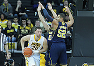 January 14, 2011: Iowa Hawkeyes forward Andrew Brommer (20) looks to pass as Michigan Wolverines guard Zack Novak (0) and Michigan Wolverines forward Jordan Morgan (52) defend during the NCAA basketball game between the Michigan Wolverines and the Iowa Hawkeyes at Carver-Hawkeye Arena in Iowa City, Iowa on Saturday, January 14, 2011. Iowa defeated Michigan 75-59.