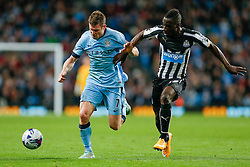 James Milner of Manchester City and Massadio Haidara of Newcastle United compete for the ball - Photo mandatory by-line: Rogan Thomson/JMP - 07966 386802 - 29/10/2014 - SPORT - FOOTBALL - Manchester, England - Etihad Stadium - Manchester City v Newcastle United - Capital One Cup Fourth Round.