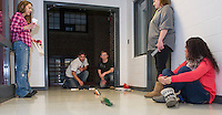 Christina Chioccola, Tiarnan McConnell and Jacob Olisky at the starting block,  Jill Fitts and Courtney St. Germain test out their CO2 Drag Racers built during Laconia Academy's Everyday Science class with Jo-Anne Gilbert.  (Karen Bobotas/for the Laconia Daily Sun)