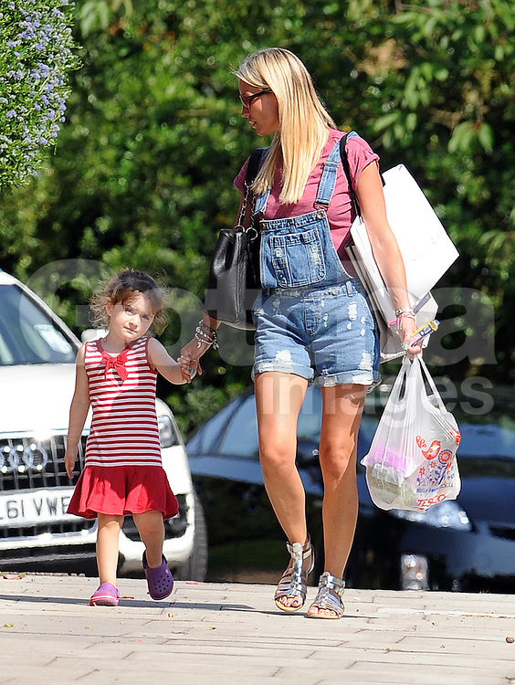 Denise Van Outen wearing a pink t-shirt, cut down dungarees and silver sandals spotted out with her daughter Betsy and husband Lee Mead in North London, UK. 11/07/2013<br />