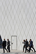 Businesspeople with geometric angles and diagonal lines on new architecture at Southwark SE1, on 7th September 2018, in London, England