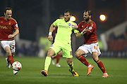 Brighton striker, Tomer Hemed (10) and Nottingham Forest defender Daniel Fox (13) during the Sky Bet Championship match between Nottingham Forest and Brighton and Hove Albion at the City Ground, Nottingham, England on 11 April 2016.