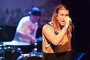 The Dirty Heads singer Jared Watson with drummer Matt Ochoa in the background.