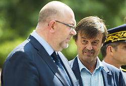 French Minister for the Ecological and Inclusive Transition Nicolas Hulot (C) speaks with French Agriculture Minister Stéphane Travert (L) and officials as they arrive to attend a biodiversity conference at Museum national d'Histoire naturelle in Paris on July 4, 2018. Photo by Eliot Blondet/ABACAPRESS.COM