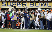 Denver Broncos outside linebacker Von Miller (58) hugs the coach after dumping a cooler full of ice and a sports drink on Denver Broncos head coach Gary Kubiak in celebration after the Broncos win the NFL Super Bowl 50 football game against the Carolina Panthers on Sunday, Feb. 7, 2016 in Santa Clara, Calif. The Broncos won the game 24-10. (©Paul Anthony Spinelli)