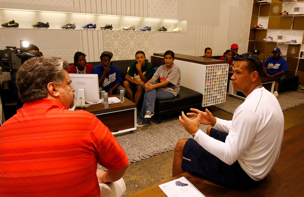 New York Yankees third baseman Alex Rodriguez talks with children from the Harlem RBI program about the importance of combining talent, hard work and determination to reach your goal's at the NIke ID store in New York City, Wednesday 02 August 2006. The children will have a chance to design a shoe using the Nike ID for Rodriguez and and his teammates.