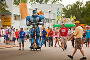 "01 SEPTEMBER 2011 - ST. PAUL, MN:  A robot goes through the fairgrounds at the Minnesota State Fair. The Minnesota State Fair is one of the largest state fairs in the United States. It's called ""the Great Minnesota Get Together"" and includes numerous agricultural exhibits, a vast midway with rides and games, horse shows and rodeos. Nearly two million people a year visit the fair, which is located in St. Paul.   PHOTO BY JACK KURTZ"