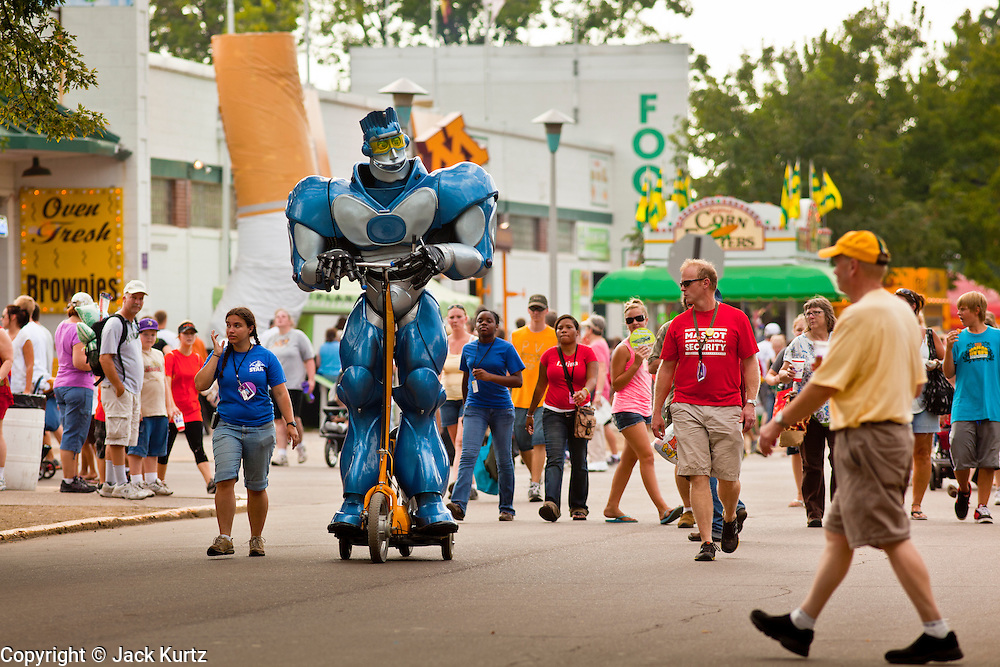 """01 SEPTEMBER 2011 - ST. PAUL, MN:  A robot goes through the fairgrounds at the Minnesota State Fair. The Minnesota State Fair is one of the largest state fairs in the United States. It's called """"the Great Minnesota Get Together"""" and includes numerous agricultural exhibits, a vast midway with rides and games, horse shows and rodeos. Nearly two million people a year visit the fair, which is located in St. Paul.   PHOTO BY JACK KURTZ"""