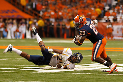Oct 21, 2011; Syracuse NY, USA;  Syracuse Orange running back Antwon Bailey (29) breaks a tackle from West Virginia Mountaineers defensive back Eain Smith (24) during the third quarter at the Carrier Dome.  Syracuse defeated West Virginia 49-23. Mandatory Credit: Jason O. Watson-US PRESSWIRE
