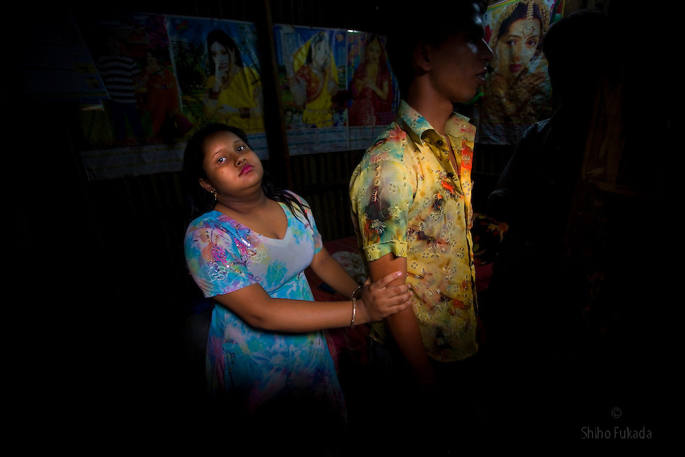 Sex worker Munnie, 15, stands with a customer at brothel, in Tangail, Bangladesh.