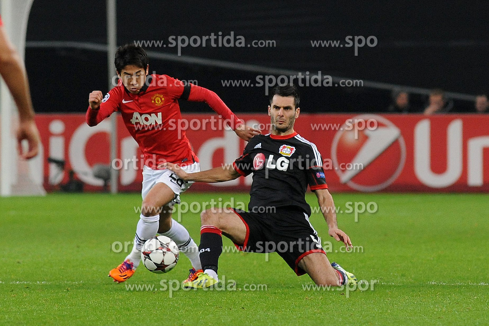 27.11.2013, BayArena, Leverkusen, GER, UEFA CL, Bayer Leverkusen vs Manchester United, Gruppe A, im Bild Shinji Kagawa ( links Manchester United ) setzt sich gegen Emir Spahic ( rechts Bayer 04 Leverkusen / Action / Aktion ) durch // during UEFA Champions League group A match between Bayer Leverkusen vs Manchester United at the BayArena in Leverkusen, Germany on 2013/11/28. EXPA Pictures &copy; 2013, PhotoCredit: EXPA/ Eibner-Pressefoto/ Thienel<br /> <br /> *****ATTENTION - OUT of GER*****