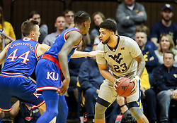 Jan 15, 2018; Morgantown, WV, USA; West Virginia Mountaineers forward Esa Ahmad (23) looks to pass during the first half against the Kansas Jayhawks at WVU Coliseum. Mandatory Credit: Ben Queen-USA TODAY Sports